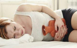 По какой причине за неделю до месячных болит живот и когда это норма