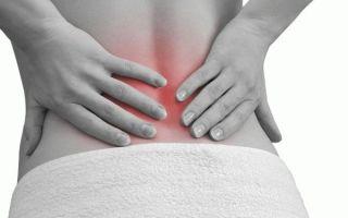 По какой причине болит спина перед месячными